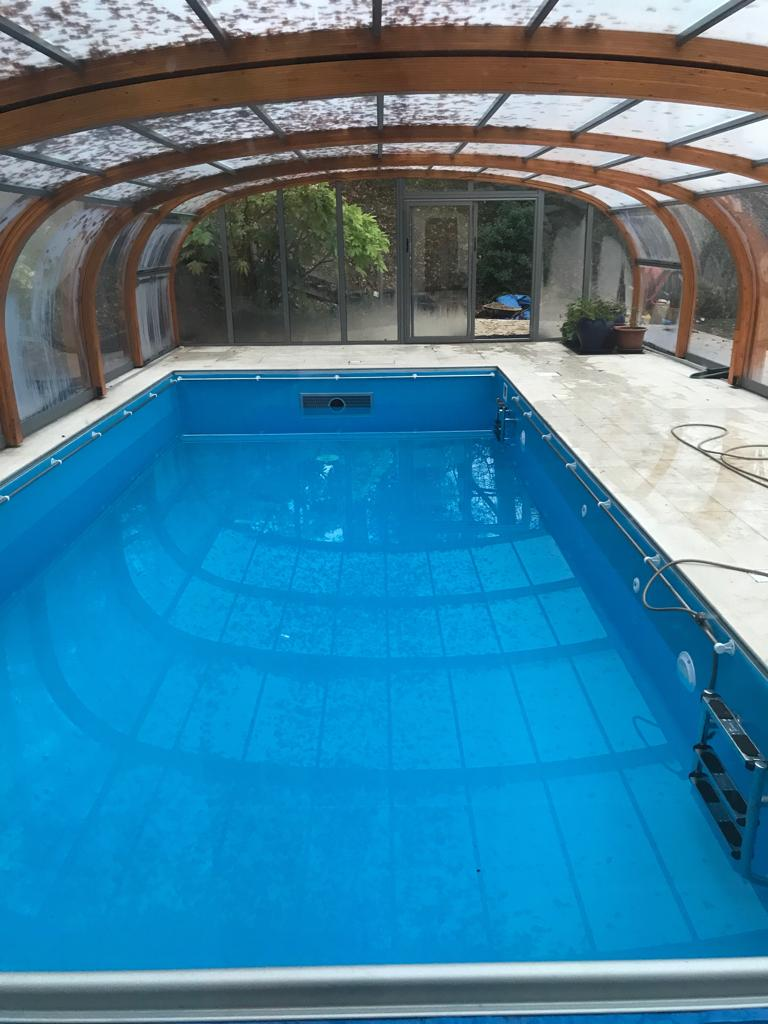 Swimming pool with retractable cover daytime photo